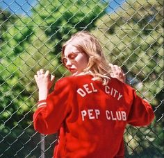 'all i know is she was blonde, she was wearing a red coat, and she's the one in charge.'