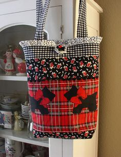 A bag I made using scottie and dog print fabrics and finished it with a little ruffled dot top and scottie button.