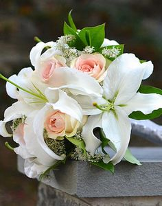 Asiatic/Oriental Lillies & Roses.  12 Wedding Flowers That Are Always in Season - WeddingWire.com