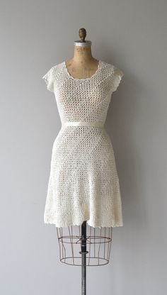 Vintage 1970s cotton crochet dress with simple shape, cap sleeves, unfitted waist and short skirt. Shown with simple ribbon belt, not included.  --- M