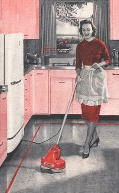 Buffing the floors after waxing. You could break your neck walking on them if you were only wearing socks.