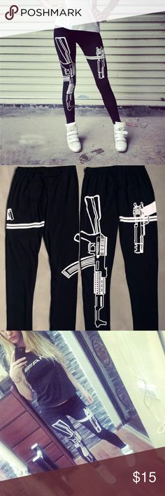 Ak47 black leggings Instantly toughen up your look with these black leggings.  Featuring a graphic of a pistol on one leg and an AK-47 on the other leg, these pants will have you looking rebelliously rad.  Rock 'em with a slouchy tee or a trapeze tank, spike studded accessories, and combat boots.   Elasticized waistband Material: 95% cotton, 5% spandex Pants Leggings