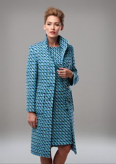 TEAL, BLACK AND WHITE TWEED SHIFT DRESS AND COAT A silk lined tweed shift dress in teal black and white with a short sleeve, patch pockets and contrast bias cut yoke panel. The coat features a silk lining, full length sleeve, pockets and metal domed buttons.