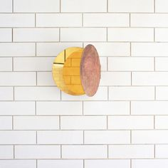 A series of hinged brass mirrors that look like butterflies when mounted on a wall by Japanese designer Morie Nishimura