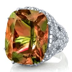 Zultanite is a color change gemstone. In daylight, the gem is a beautiful kiwi to lime green. When moving to low inside or candlelight, Zultanite will slowly change from champagne to cinnamon, peach and sometimes a cherry pink.