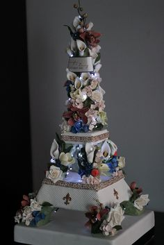 My Eiffel Tower Wedding Cake with the lights dimmed to show the lights on the cake topper.