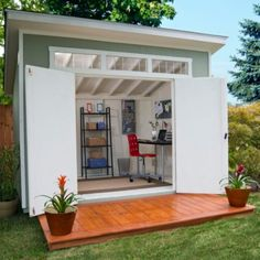 a cool tiny office - retreat - LOVE The double doors -  To connect with us, and our community of people from Australia and around the world, learning how to live large in small places, visit us at www.Facebook.com/TinyHousesAustralia or at www.TinyHousesAustralia.com