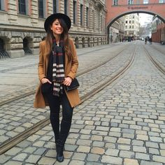 Mimi Ikonn | Camel coat, checkered scarf, black hat, black skinny jeans, black boots. Germany outfit