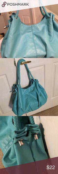 """Large turquoise bag Huge soft faux bag with lots of room for all your """"stuff"""". 1 zip compartment outside and 1 zip compartment inside plus pockets. Very good condition as only used twice. Bags"""