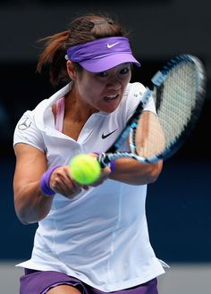 Na Li of China plays a backhand in her Quarterfinal match against Agnieszka Radwanska of Poland during day nine of the 2013 Australian Open at Melbourne Park on January 22, 2013 in Melbourne, Australia.
