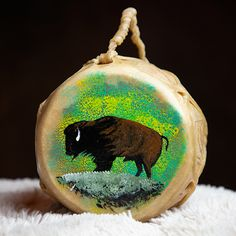 This two sided drum is hand-made from rawhide and wood that has been painted with a buffalo. Powwow drums and hand drums have spanned many generations. It measures six inches in diameter with the painting on the top. #nativeamerican #drum #handdrum #handmade #handcrafted #music #painteddrum #painted #buffalo #bison #navajo #powwow #instrument Native American Instruments, Hand Drum, Pow Wow, Bison, Navajo, Drums, Buffalo, Christmas Bulbs, Art Gallery