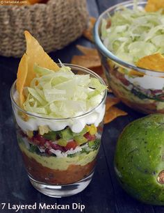 7 layered Mexican dip 😍😍 Ingredients For The Refried Beans 1 cups soaked , boiled and coarsely mashed rajma (kidney beans) 1 tbsp oil… Mexican Dip Recipes, Mexican Dips, Veg Recipes, Mexican Food Recipes, Vegetarian Recipes, Snack Recipes, Cooking Recipes, Snacks, Mexican Party