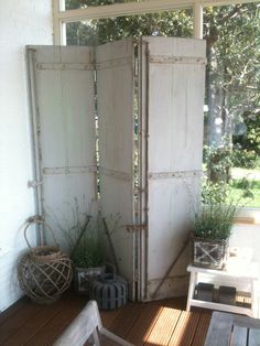 old french shutters used as roomdivider