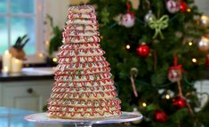 "Paul Hollywood make a kransekake Scandinavian cake for the festive season on The Great British Bake Off Christmas Masterclass. Paul says: ""Kransekake is a Scandinavian cake that forms an impressive showpiece at celebrations including weddings and Christmas."" The ingredients are: 500g ground almonds, 500g icing sugar, sifted, 4 free-range egg whites, lightly whisked, 1 tsp almond extract, vegetable oil, for greasing, semolina, for dusting and plain flour, for dusting. For the icing: 3…"