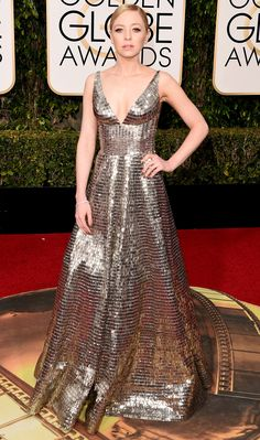 PORTIA DOUBLEDAY goes full disco-ball in a mirrored Naeem Khan gown with V-neckline, plus a delicate Simon G. Jewelry diamond bracelet.