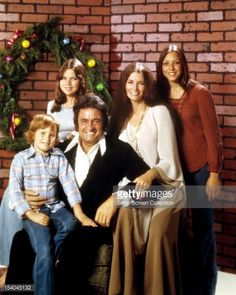 American country singer-songwriter Johnny Cash (1932 - 2003) with his wife June Carter Cash (1929 - 2003) and three of their children, circa 1976. Left to right; John Carter Cash, Rosanne Cash, Johnny Cash, June Carter Cash and Carlene Carter.