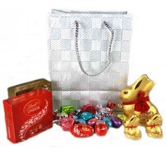 Purchase lindts easter gift basket at just 4500 from gifts 2 the gifts 2 the door offers some amazing easter gifts including lindt easter bag at just 5200 negle Images