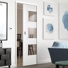 Single Pocket Amsterdam 3P White Primed Door with Clear Safety Glass - Lifestyle Image.    #whitedoor #slidingdoor