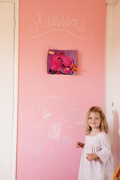 One pink chalkboard wall. One happy girl.
