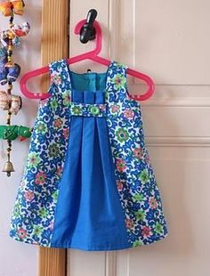 Girl's dress with front pleats.  No pattern.