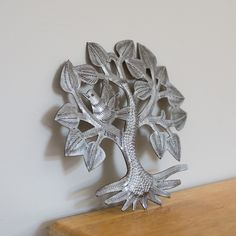 """This is a miniature version of the popular Haitian Tree of Life. Each piece is hammered by hand out of a recycled 55 gallon steel drum.  6"""" Diameter Made in Croix-des-Bouquets, Haiti Made by Louis Juste Omiscar Metal Drum, Steel Metal, 55 Gallon Steel Drum, Drums Art, Haiti, Tree Of Life, Bouquets, Art Pieces, Miniatures"""