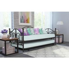Get extra seating and additional sleeping space all in one with this DHP Bombay twin mattress daybed, which comes with a trundle bed underneath. The whimsical scrollwork lends your room a fun feel, wh