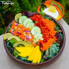 Tonight's fine dining: FullyRaw Tex Mex Bowl! Dark leafies colored with sliced mango, cucumber, rainbow bell peppers, carrots, onions, and avocado with a side dressing of light and creamy lemon tahini! Buen provecho!   -   Kristina Carrillo-Bucaram Rawfully Organic Co-op www.instagram.com/fullyrawkristina
