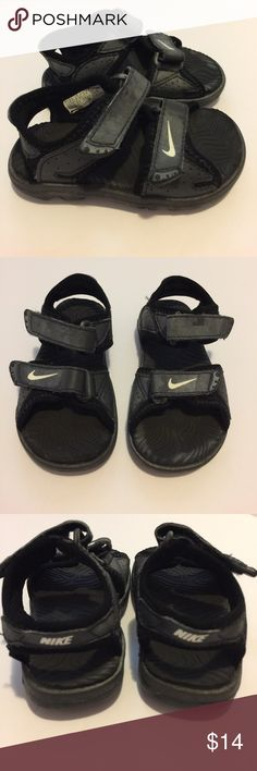 Cute Nike Sandals size 5 Velcro Adjust Closure Cute Nike Sandals size 5 2 strap Velcro Adjustable Closure. Black with some fading do to chlorine. Other than some fading these are in awesome condition. Perfect for summer water play, pools, and beaches. They look adorable with shorts and a tee. Nike Shoes Sandals & Flip Flops