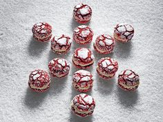 Red Velvet Crackle Sandwich Cookies | These festive sandwich cookies pack all of the flavor of a red velvet cake in one cute little package. We paired tender chocolate crackle cookies (made red with just a touch of food coloring) with a smooth and tangy cream cheese frosting. When scooping the batter, a trigger-handled ice cream scoop makes the work of getting uniform cookies a breeze. The filling and cookies can be made up to three days in advance if stored separately in an airtight…
