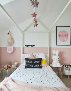 A house bed in a girls bedroom. Pink half painted walls and touches of Monochrome, make this a room to grow with them.