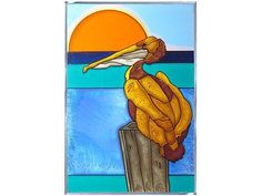"""""""Stained Art Glass PELICAN Suncatcher"""" The pelican in this hand-painted art glass panel will bring a touch of whimsey to any nautical decor. This hand-painted vertical panel is zinc-framed and measure"""