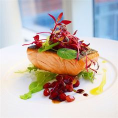 Herb crusted king salmon, Topped sherry balsamic pomegranate gastrique, chard micros and frisée, on wasabi pea purée