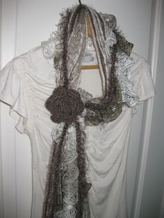 Slip-n-Go Fringe Scarf-Smokey Quartz-Taupe colors with warm beige and cream with crochet flower. $22.00, via Etsy.