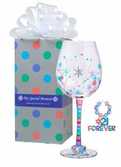 "MoMo Panache My Special Moment Forever 21 Wine Glass with Charm, Gift Boxed by MoMo Panache. $27.63. Holds 14oz liquid. Hand painted. Mouth blown. Not diswasher safe. Hand Wash Only. Holds 14-ounces liquid. MoMo Panache's My Special Moment 21 Forever 14oz wine glass is mouth blown, hand cut and hand painted.  Includes a removable charm that says ""21 Forever""  Gift boxed and includes white self-flower bow. Who among us does not want to proclaim, 21 FOREVER!"