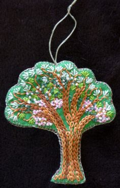 tree embroidered ornament, I like the use of chain stitch for the trunk