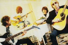 Bob Dylan And Friends: Through The Years   American Songwriter -With the Traveling Wilburys, 1990 (Dylan on bass).