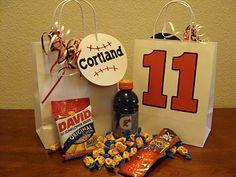 Baseball...so cute!!!  peanuts, crackerjacks, big league chew.  I did this for my hubby's birthday one year!