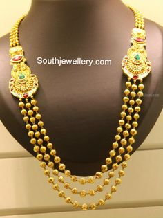 Simple three stringed gundla mala with gold balls chains attached to kundan motifs on either side from Kirtilal's Jewellers