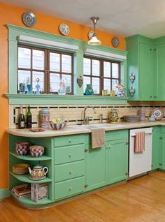 The use of period colors is evident in the kitchen of the restored 1906 bungalow. The maple strip flooring, top nailed, replicates the original damaged in a 1920s woodstove fire. by lenore