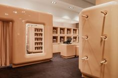 Central to the store's distinctive design is the shiny, beige-coloured partitions and shelving units.