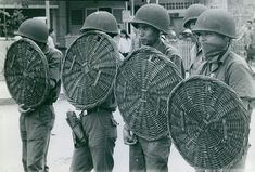 Vintage photo of Vietnamese soldiers using rattan shields. This photograph originates from the International Magazine Services photo archive. IMS was a editorial photo archive in Scandinavia founded in 1948 but