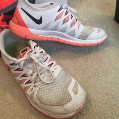 Nike free 5.0 Very worn. Please look at pictures. Bright orange and white Nike Shoes Sneakers