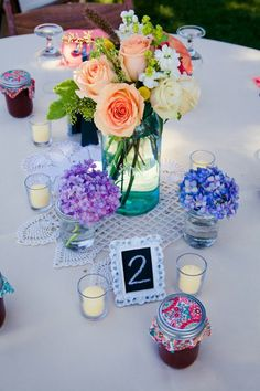 @Elyce Hornor I like the simplicity of these centerpieces.  Also, look at the pics of her dress...look familiar? :)