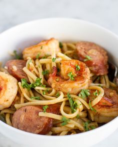 One-Pot Cajun Shrimp & Sausage Pasta Spice Things Up With This One-Pot Cajun Shrimp Pasta Dish Shrimp And Sausage Pasta, Shrimp Pasta Dishes, Cajun Shrimp Pasta, Seafood Dishes, One Pot Cajun Pasta, Cajun Sausage, Spicy Shrimp, Cajun Recipes, Seafood Recipes