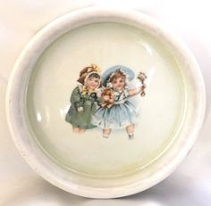 This is a sweet antique baby dish made in Germany. It has a greenish iridescent finish on the interior. Rock A Bye Baby, Spoon Rest, Baby Food Recipes, Iridescent, German, Plates, Ceramics, Antiques, Unique Jewelry