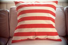 Coral and white striped throw pillow cover. $20.00, via Etsy.