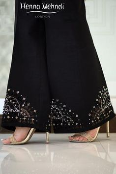 Black Raw Silk Embellished Cutwork Trousers - Ready Made Indian & Pakistani Clothes, Salwar Kameez, Outfits, Dresses, Suits & Trousers to Buy Online – Henna Mehndi Pakistani Dress Design, Pakistani Outfits, Indian Outfits, Look Fashion, Fashion Pants, Mehndi Fashion, Modest Fashion Hijab, Fashion Dresses, Velvet Dress Designs
