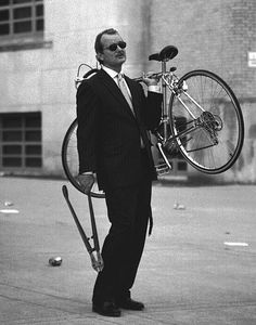 Bill Murray carries his bicycle...