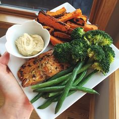 """""""Lunch today! Salmon seasoned with lemon pepper and curry powder, sea salt & vinegar sweet potato fries, steamed broccoli and green beans with hummus to…"""""""