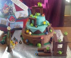 Angry Birds My grandsons birthday cake ! I made a really working sling shot and fondant birds he was able to shoot at the cake structure...